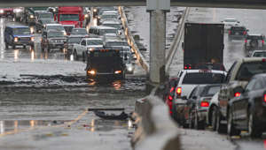 HOUSTON, TX - SEPTEMBER 19: Cars pull to the side of the freeway of highway 69 North to get by the flood waters on September 19, 2019 in Houston, Texas.  Gov. Greg Abbott has declared much of Southeast Texas disaster areas after heavy rain and flooding from the remnants of Tropical Depression Imelda dumped more than two feet of water across some areas. (Photo by Thomas B. Shea/Getty Images)