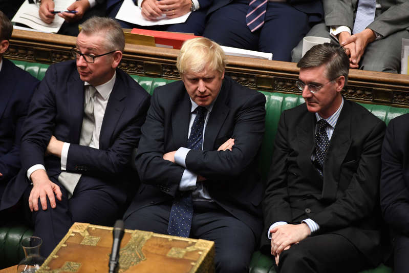 Britain's Prime Minister Boris Johnson, Chancellor of the Duchy of Lancaster Michael Gove (L), and leader of the House of Commons Jacob Rees-Mogg (R) attend in the House of Commons in London, Britain September 3, 2019. ©UK Parliament/Jessica Taylor/Handout via REUTERS ATTENTION EDITORS - THIS IMAGE WAS PROVIDED BY A THIRD PARTY