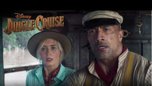 Dwayne Johnson wearing a hat: Join the adventure of a lifetime and watch the action-packed new trailer for Disney's JUNGLE CRUISE.  The trailer was launched via a fun-filled Instagram Live featuring Dwayne Johnson, interacting with a boat full of skippers from the Jungle Cruise attraction at The Disneyland Resort.  Inspired by the famous Disneyland theme park ride, Disney's JUNGLE CRUISE is an adventure-filled, Amazon-jungle expedition starring Dwayne Johnson as the charismatic riverboat captain and Emily Blunt as a determined explorer on a research mission. Also starring in the film are Edgar Ramirez, Jack Whitehall, with Jesse Plemons, and Paul Giamatti.  Jaume Collet-Serra is the director and John Davis, John Fox, Dwayne Johnson, Hiram Garcia, Dany Garcia and Beau Flynn are the producers, with Doug Merrifield serving as executive producer.  Disney's JUNGLE CRUISE opens in U.S. theaters on July 24, 2020.