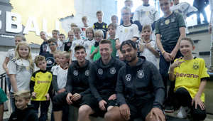 DORTMUND, GERMANY - OCTOBER 11: Kai Havertz, Marco Reus and Serge Gnabry of Germany pose with kids after a press conference at Deutsches Fussball Museum on October 11, 2019 in Dortmund, Germany. Germany will play against Estonia the UEFA Euro 2020 qualifier match on October 13, 2019 in Tallinn, Estonia. (Photo by Christof Koepsel/Bongarts/Getty Images)