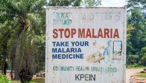 A sign reads 'Stop Malaria' Ganta, Liberia. (Photo by: Edwin Remsberg/VWPics/UIG via Getty Images)