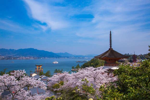24 枚のスライドの 9 枚目: Hatsukaichi, Hiroshima Prefecture, Japan - April 1, 2014: It is spring scenery of Miyajima with Itsukushima Shrine is a UNESCO World Heritage Site