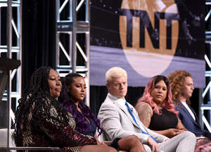 "BEVERLY HILLS, CALIFORNIA - JULY 24: (L-R) Kia Stevens aka Awesome Kong, Brandi Rhodes, Cody Rhodes, Nyla Rose, and Jack Perry aka Jungle Boy speak onstage at the ""All Elite Wrestling"" panel during the TBS + TNT Summer TCA 2019 at The Beverly Hilton Hotel on July 24, 2019 in Beverly Hills, California. 637825 (Photo by Presley Ann/Getty Images for TNT)"
