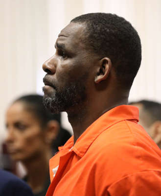 a man looking at the camera: R. Kelly appears during a hearing at the Leighton Criminal Courthouse on Sept. 17, 2019, in Chicago. Kelly is facing multiple sexual assault charges and is being held without bail.