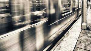 a blurry image of a train station: Subway trains can speed up, says Governor Cuomo, citing task force findings