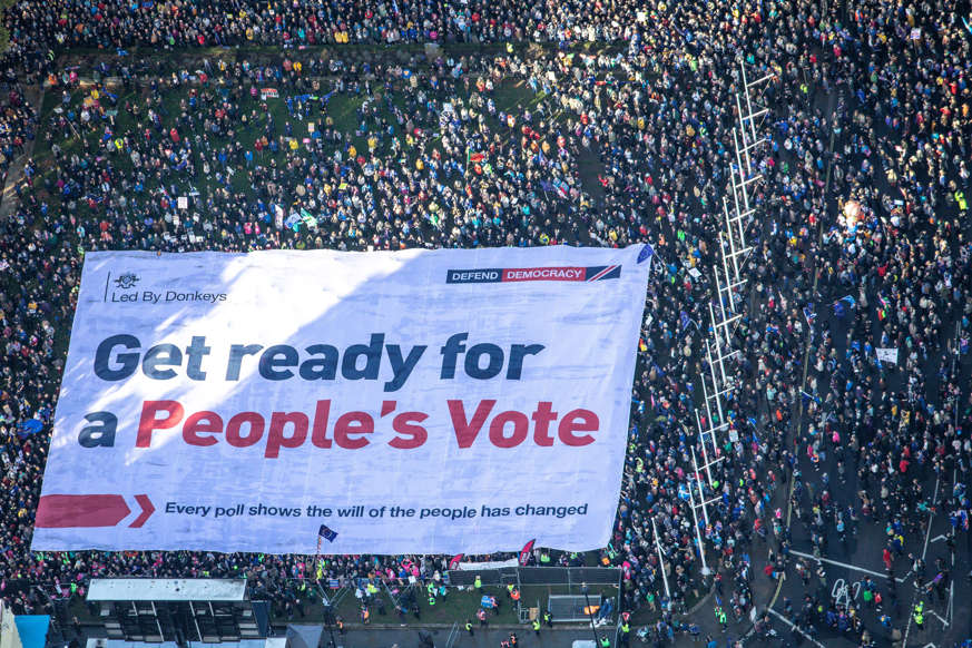 Slide 42 of 48: An aerial view shows Brexit accountability campaign group Led By Donkeys unfurling a large crowd banner, as a spoof of the government's advertising campaign, at Parliament Square, London, Britain October 19, 2019. Led By Donkeys/Handout via REUTERS THIS IMAGE HAS BEEN SUPPLIED BY A THIRD PARTY. MANDATORY CREDIT
