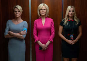 "Michele Kambolis, Margot Robbie standing in front of a mirror posing for the camera: Charlize Theron (left) stars as Megyn Kelly, Nicole Kidman plays Gretchen Carlson and Margot Robbie is Kayla Pospisil in ""Bombshell."""