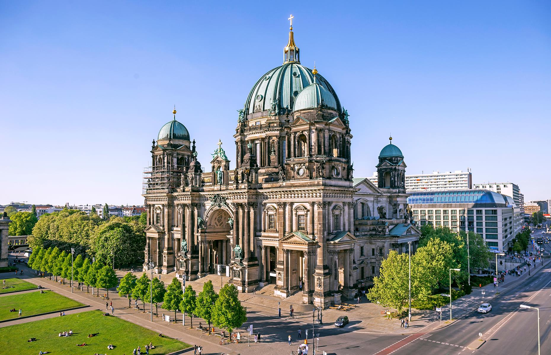 Slide 9 of 31: Despite its name, Berlin Cathedral has never been an actual cathedral as it's never been the seat of a bishop, but it's still a stunner. The Neo-Renaissance building has four towers and an impressive dome topped with a golden cross. Located on Berlin's Museum Island, the church was finished in 1905 and houses not only a place of worship but a museum and concert hall too. Plan your visit to Berlin with our top guide.