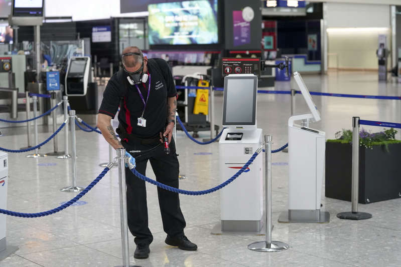 A staff member cleans in Terminal 5 at Heathrow Airport in west London ahead of international travel restarting on Monday May 17, following the further easing of lockdown restrictions. Picture date: Thursday May 13, 2021. (Photo by Steve Parsons/PA Images via Getty Images)