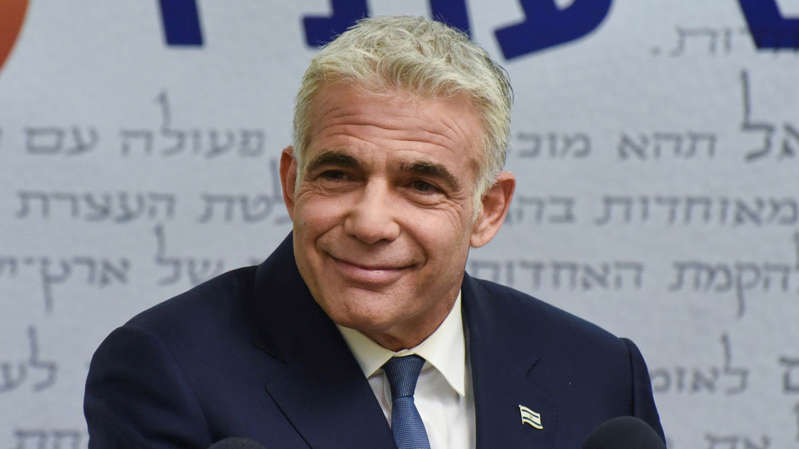 Yair Lapid wearing a suit and tie: Israeli foreign minister Yair Lapid blamed 'Iranian terrorism' for the attack