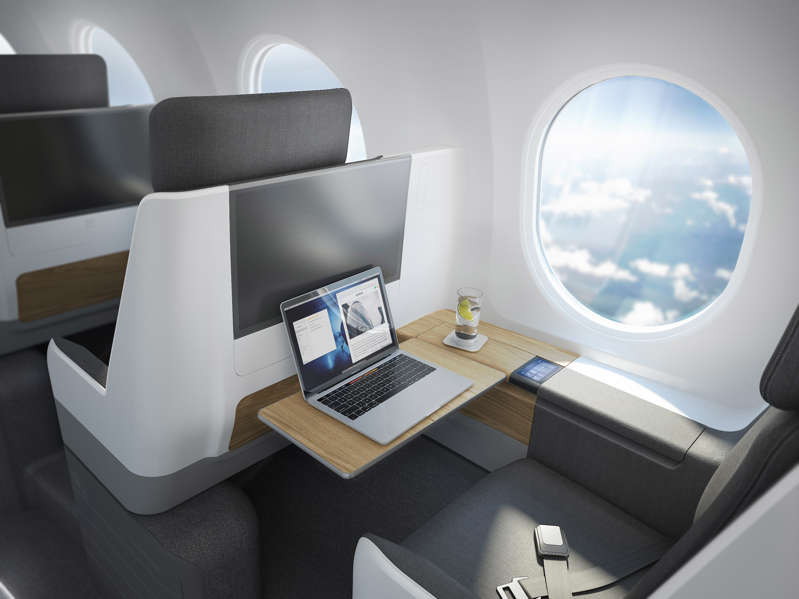 a bedroom with a desk and chair in a room:  (Copyright © 2021 Boom Supersonic)
