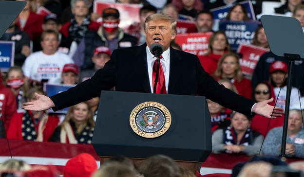 Donald Trump standing in front of a crowd: He praised former US President Donald Trump's 'draining of the swamp' in the YouTube video. Pic: GettyImages