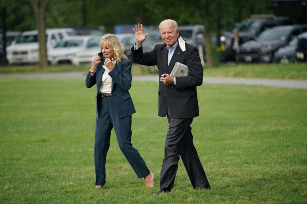 Slide 19 of 19: US President Joe Biden and First Lady Jill Biden make their way to board Marine One before departing from The Ellipse, near the White House, in Washington, DC on June 9, 2021. President Biden is traveling to the United Kingdom, Belgium, and Switzerland on his first foreign trip.