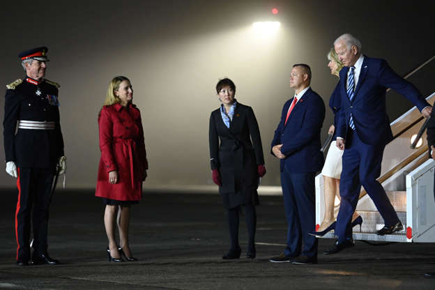 Slide 1 of 19: Colonel Edward Bolitho, Lord Lieutenant of Cornwall (L), and Yael Lempert, Charge dAffaires ad interim at the US Embassy in London (2nd L), stand to greet US President Joe Biden and First Lady Jill Biden as they arrive at Cornwall Airport in Newquay, Britain, on June 9, 2021, ahead of the three-day G7 Summit. G7 leaders from Canada, France, Germany, Italy, Japan, the UK and the United States meet this weekend for the first time in nearly two years, for the three-day talks in Carbis Bay, Cornwall.