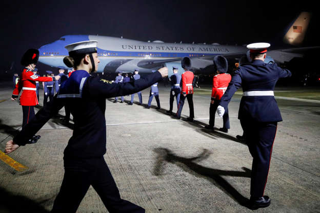 Slide 3 of 19: Military personnel march to welcome U.S. President Joe Biden and first lady Jill Biden upon the arrival of Air Force One at Cornwall Airport Newquay, on June 9, 2021 near Newquay, Cornwall, England.