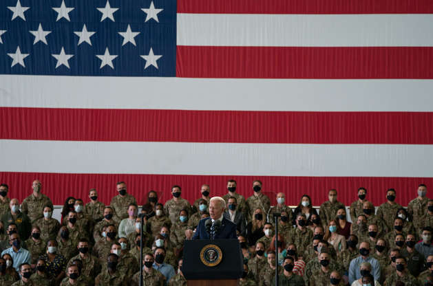 Slide 7 of 19: US President Joe Biden addresses US Air Force personnel at RAF Mildenhall in Suffolk, ahead of the G7 summit in Cornwall, on June 9, 2021 in Mildenhall, England.