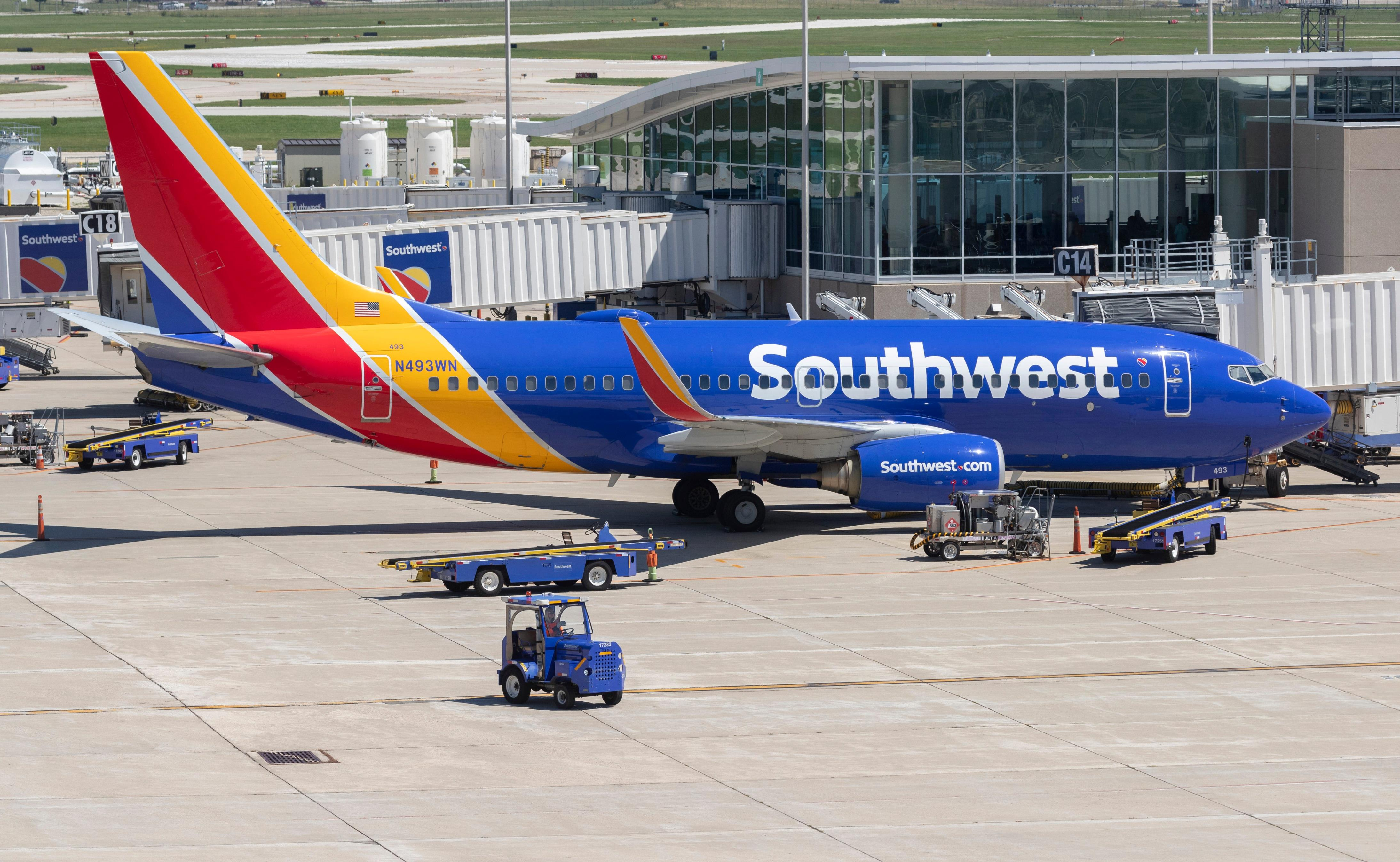 Slide 17 of 17: Baggage is loaded onto a Southwest Airlines plane Wednesday, August 12, 2020 at Mitchell Airport. in Milwaukee, Wis. The COVID-19 pandemic severely affected multiple airline companies and the travel industry as a whole.