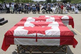 Caskets draped in Canadian flags are on display at a funeral for four Muslim family members killed in a deadly vehicle attack.