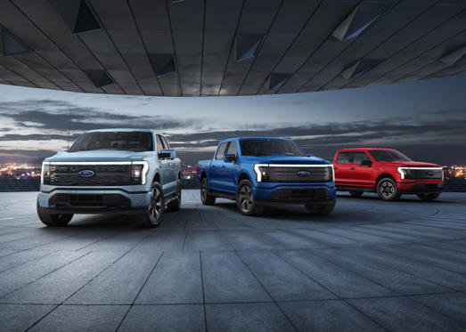 a car parked in a parking lot: Meet the 2022 Ford F-150 Lightning.