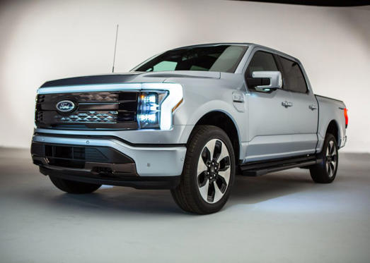 a car parked in a parking lot: The 2022 Ford F-150 Lightning is a game-changing truck.