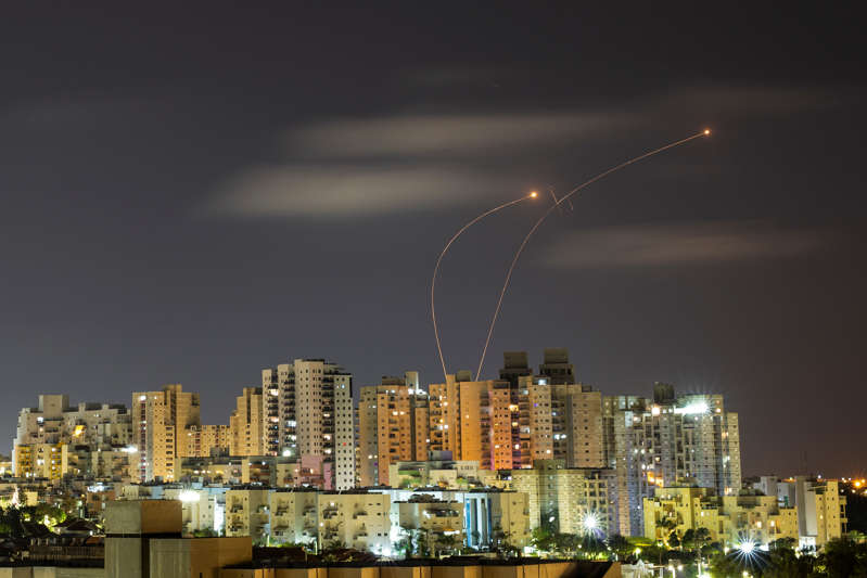Streaks of light are seen as Israel's Iron Dome anti-missile system intercepts rockets launched from the Gaza Strip towards Israel, as seen from Ashkelon May 20, 2021 REUTERS/ Amir Cohen