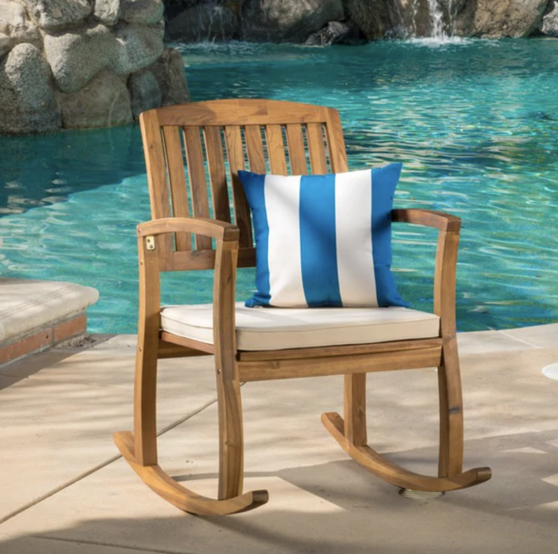 a chair sitting in front of a pool of water: Christopher Knight Home Lucca Outdoor Rocking Chair