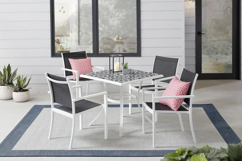 a dining room table in front of a window: Marivaux Black and White 5-Piece Steel Outdoor Patio Dining Set