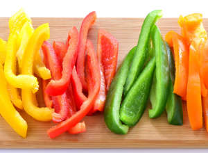 food on the cutting board: bell peppers
