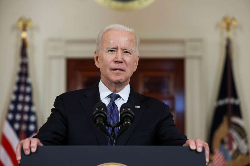 U.S. President Joe Biden delivers remarks before a ceasefire agreed by Israel and Hamas was to go into effect, during a brief appearance in the Cross Hall at the White House in Washington, U.S., May 20, 2021. REUTERS/Jonathan Ernst