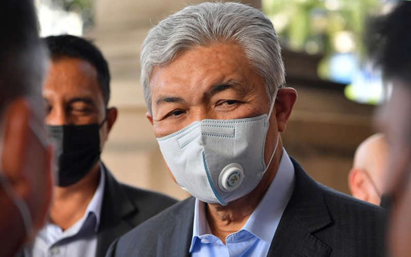 a man wearing a suit and tie: Former home minister Ahmad Zahid Hamidi is standing trial on 47 charges of money laundering and CBT involving millions from his foundation, Yayasan Akalbudi. (Bernama pic)