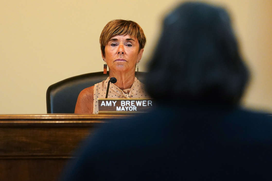 """a man looking at the camera: Lebanon Mayor Amy Brewer listens to a speaker as Lebanon city council considers voting on a proposed ordinance which would declare the city of 20,000 in Warren County, north of Cincinnati, a """"sanctuary city for the unborn,"""" Tuesday, May 25, 2021, in Lebanon, Ohio."""