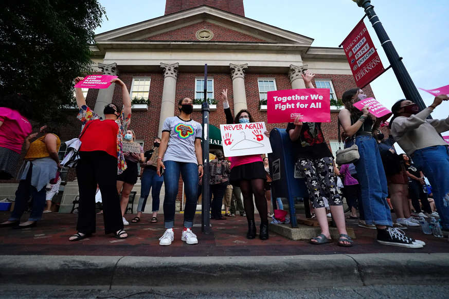 """Slide 3 of 27: Pro-choice protesters gather outside Lebanon town hall as city council considers voting on a proposed ordinance which would declare the city of 20,000 in Warren County, north of Cincinnati, a """"sanctuary city for the unborn,"""" Tuesday, May 25, 2021, in Lebanon, Ohio."""