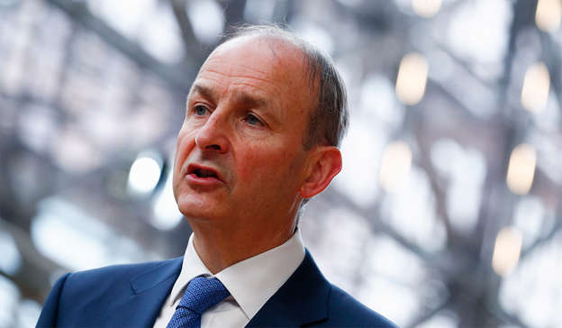 Micheal Martin wearing a suit and tie: In May of this year, Taoiseach Micheál Martin said that such leases, which last for 25 years and result in the State not owning the home, amounted to a 'bad deal'. Pic: Johanna Geron, Pool via AP