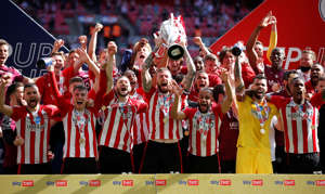 Soccer Football - Championship Play-Off Final - Brentford v Swansea City - Wembley Stadium, London, Britain - May 29, 2021 Brentford's Pontus Jansson lifts the trophy as they celebrate after winning Championship Play-Off Final Action Images via Reuters/Matthew Childs TPX IMAGES OF THE DAY