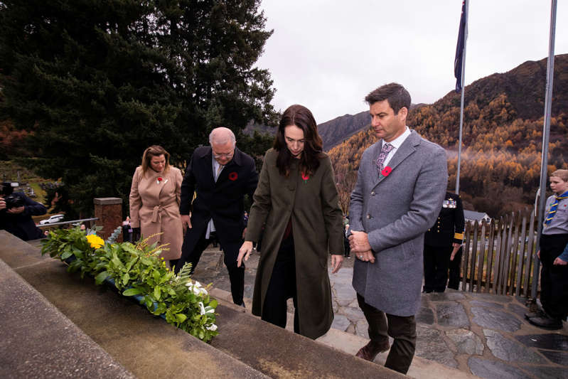 OTAGO, NEW ZEALAND - MAY 31: (L-R) Jenny Morrison, Prime Minister Scott Morrison of Australia, Prime Minister Jacinda Ardern of New Zealand and Clarke Gayford attend a memorial service at Arrowtown War Memorial on May 31, 2021 in Otago, New Zealand. The Prime Ministers of Australia and New Zealand arrived to lay wreathes at the base of the Arrowtown memorial in honor of those who lost their lives in past wars. (Photo by Robert Kitchin-Pool/Getty Images)