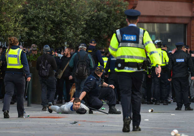 A group of Anti-Lockdown protesters clash with Gardai (Irish Police) in Grafton Street, Dublin, during Level 5 Covid-19 lockdown. On Saturday, Fabruary 27, 2021, in Dublin, Ireland.