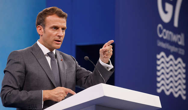 Emmanuel Macron wearing a suit and tie: President Emmanuel Macron paid tribute to the family of Sophie Toscan du Plantier during a visit to Government Buildings in Dublin on Thursday. Pic: LUDOVIC MARIN/AFP via Getty Images