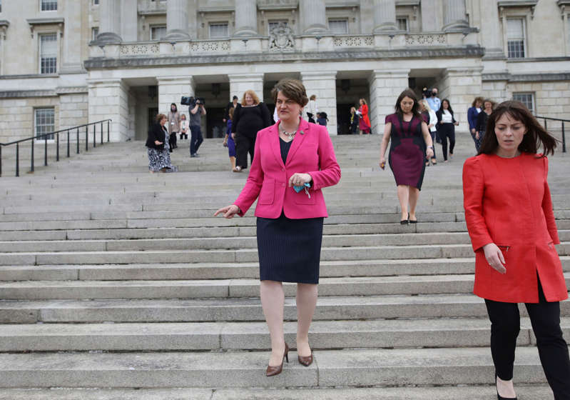 Northern Ireland First Minister Arlene Foster, centre, walks down the steps of Stormont Buildings parliament in Belfast, Northern Ireland, Tuesday, June 8, 2021. The First Minister is due to step down later this month after the party leader Edwin Poots announced Tuesday that Paul Givan would take over the position. (AP Photo/Peter Morrison)