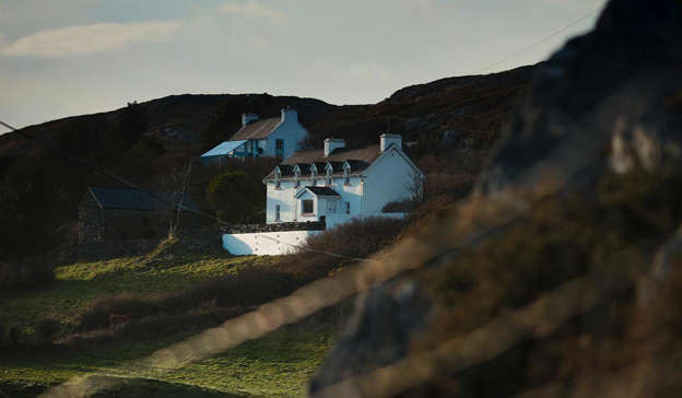 a person standing on top of a mountain: A neighbour of the Toscan du Plantier home in West Cork has sold their house amid a surge in dark tourism to the area.