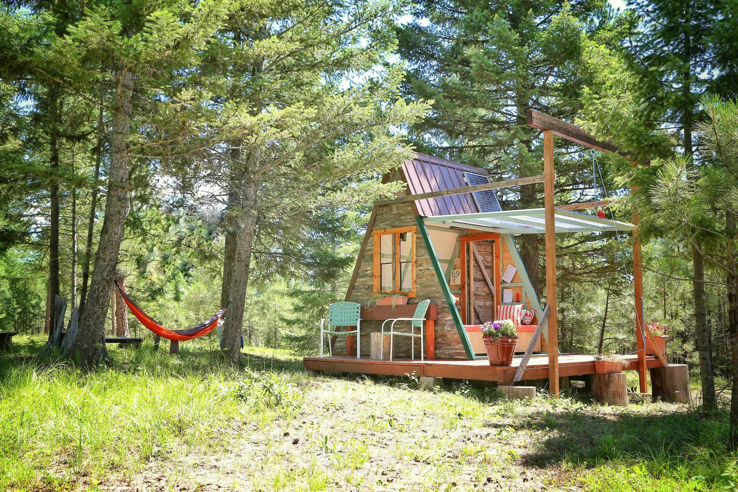 Slide 9 of 15: Both a tiny home and an A-frame, this quirky, rustic cabin is a glamping destination. It's nestled between Glacier and Yellowstone national parks in Montana, and wild elk sightings are not unheard of. Relax in the hot tub or take a fully solar outdoor shower after a long day of exploring the 100-acre property and nearby hiking trails. $189, Airbnb. Get it now!