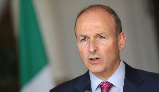 Micheal Martin wearing a suit and tie smiling at the camera: Micheál Martin should step down as Fianna Fáil leader when his term as Taoiseach ends next year, a majority of respondents to an Irish Mail on Sunday-Ireland Thinks poll believe Pic: Julien Behal
