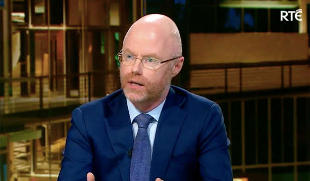 Stephen Donnelly wearing a suit and tie: Viewers of RTE's Prime Time were left raging on Tuesday by Minister for Health Stephen Donnelly's 'car crash' interview concerning the delay in reopening hospitality. Pic: RTE/ Prime Time