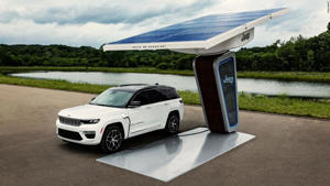 a car parked on the side of a road: Jeep promises more plug-in vehicles like thisGrand Cherokee 4xe.