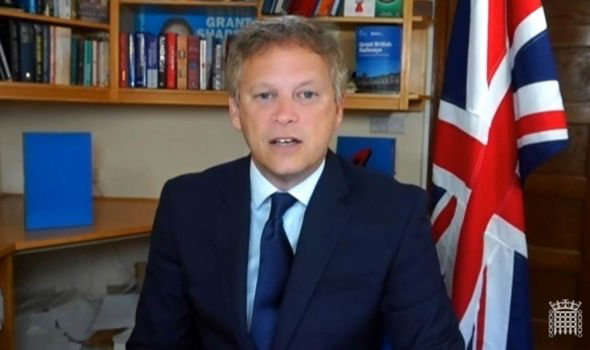 a young boy wearing a suit and tie: shapps