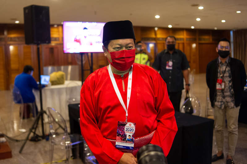 a man wearing a hat: Umno secretary-general Datuk Seri Ahmad Maslan today confirmed that the party sacked two of its state assemblymen who betrayed the Barisan Nasional-led Melaka government. ― Picture by Shafwan Zaidon