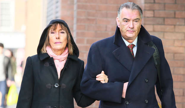Ian Bailey wearing a suit and tie standing next to a woman: Ian Bailey, who was convicted of assaulting his partner Jules Thomas, who he is now separated from, called his past actions of domestic violence 'shameful'. Pic: Collins