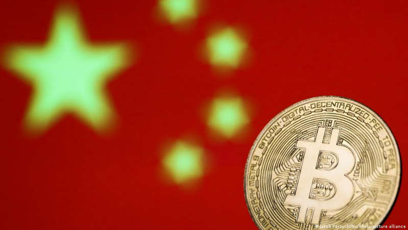 a close up of a logo: It's the latest move by Beijing to crack down on cryptocurrency trading