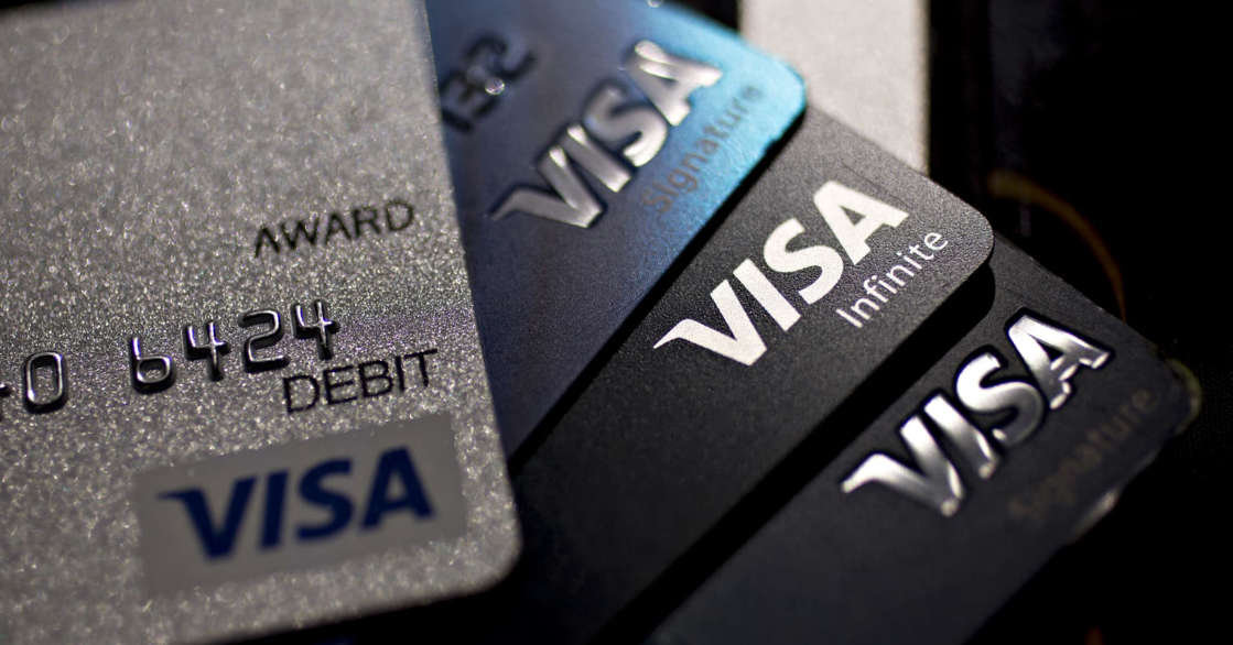 Visa Inc. credit and debit cards are arranged for a photograph in Washington, D.C., U.S., on Monday, April 22, 2019.