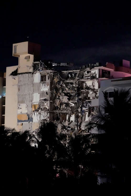 Slide 58 of 58: A partial collapsed building is seen early Thursday, June 24, 2021, in Surfside area of Miami, Fla.