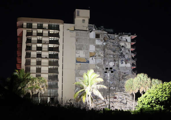 Slide 25 of 34: A portion of the 12-story condo tower crumbled to the ground during a partial collapse of the building on June 24, 2021 in the Surfside area of Miami, Fla. It is unknown at this time how many people were injured as search-and-rescue effort continues with rescue crews from across Miami-Dade and Broward counties.